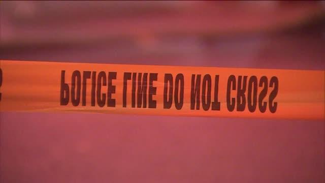 Police Investigate a Crime Scene 'Do not Cross'