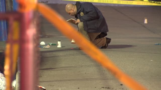 Police investigate crime scene in Crown Heights Brooklyn where an officer was shot three times