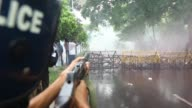 Police lobbed several tear gas canisters and used water cannons as left wing students march in the street towards the Supreme Court to protest in...