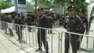Police media and supports wait for former Prime Minister Yingluck Shinawatra to attend the verdict in her trial over a rice subsidy scheme outside...