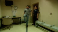 MS Police officer and man entering room where man is given sobriety test/ New Jersey