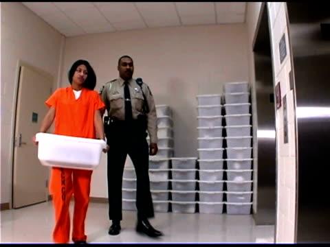 Police officer and prisoner on elevator
