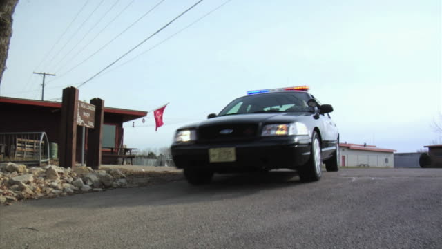 WS LA Police officer pulling up to scene, getting out and running, New London, Wisconsin, USA