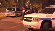 WGN Police Officer Rolling Out Crime Tape on October 14 2013 in Chicago Illinois