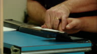 CU Police officer taking fingerprints of arrested person/ New Jersey