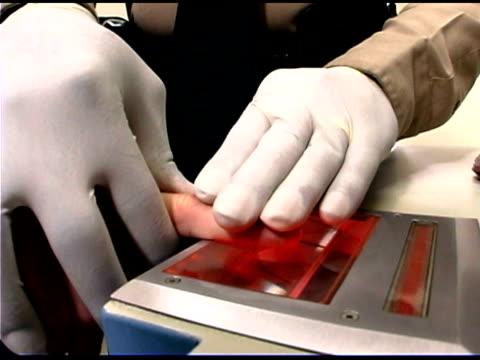 Police officer taking fingerprints