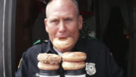 CU Police officer with doughnuts and coffee / Dallas, Texas, USA