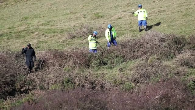 Police officers continue their investigation into the disappearance of Gaia Pope by searching the land above the coast between Durlston Country Park...