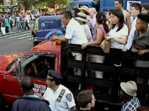 Police officers directing traffic on crowded street near entrance to Queensboro Bridge during citywide blackout on August 14 2003 / New York New York...