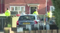 Police officers go to the house where they believe the alleged perpetrator of the deadly Manchester attack lived