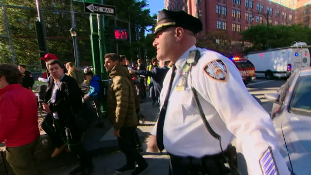 Police officers moving on pedestrians after the Manhattan terror attack