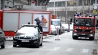 Police officers stand guard at the Rue de la Loi following a blast at the Maalbeek Metro station in Brussels Belgium on March 22 2016 At least 34...
