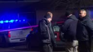WGN Police Officers Standing At Crime Scene on December 10 2012 in Chicago Illinois