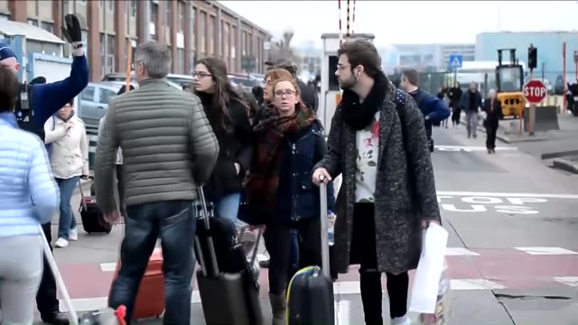 Police officers take security measures around the Zaventem Airport as passengers are evacuated after two explosions went off in Brussels Belgium on...
