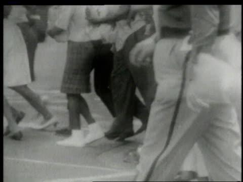 Police running toward civil rights rioting / Alabama United States