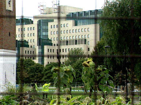 Police search a park opposite the MI6 headquarters following a missile attack on the building 20 Sep 2000