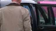 Police search garages in hunt for body of murdered schoolgirl Danielle Jones Linda and Tony Jones into car and away