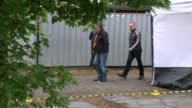 Police search garages in hunt for body of murdered schoolgirl Danielle Jones EXT Tony Jones and Linda Jones along past forensic tents with police