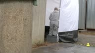 Police search garages in hunt for body of murdered schoolgirl Danielle Jones Forensics along by police tents