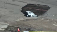 KDVR A police sergeant was shaken up after a sinkhole swallowed his SUV squad car on June 5 2105 in Colorado Police say the SUV was entering an...