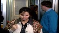 INT Mrs Talb wife of Mohammed Uppsala Abu Talb Terrorist Suspect walking along Mrs Talb chatting Female Police Officer with metal detector...