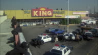 WS HA ZI Police SWAT team surrounding shopping market parking lot