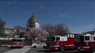 Police take security measures and fire trucks are placed around the US Capitol as the building was placed on lockdown after a man reportedly...