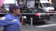 Police take security measures followning an attacker was shot by New York City Police Department officer after he attacked and maimed an offduty...