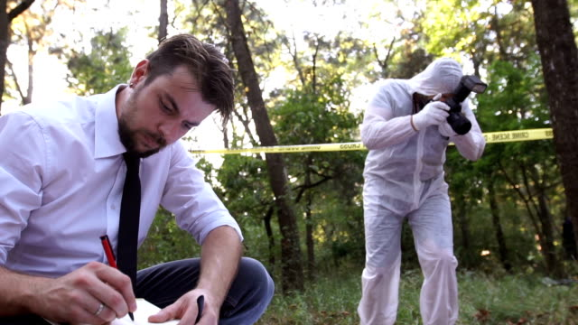 Police taking notes at murder scene