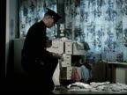 1965 MS Police taking notes on clipboard in bedroom crime scene/ CU Officer collecting burnt match as evidence with tweezers and putting them in bag/ Oakland, California/ AUDIO