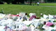 Police use videosharing website to appeal for information on murder of Jessie James FILE / TX Moss Side EXT Floral tributes on grass where Jessie...