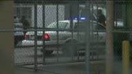 Police vehicles move Robert Durst to Elayn Hunt Correctional Center on March 17 2015 in New Orleans Louisiana