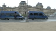 Police vehicles outside the Louvre after a man attempted to attack soldiers inside