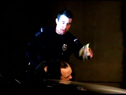 Policeman arresting criminal with bag of marijuana