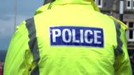 4K: Policeman in Hi vis Flourescent Police vest jacket