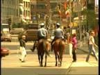 MS 2 policemen on horses patrolling in midtown, away from camera, New York