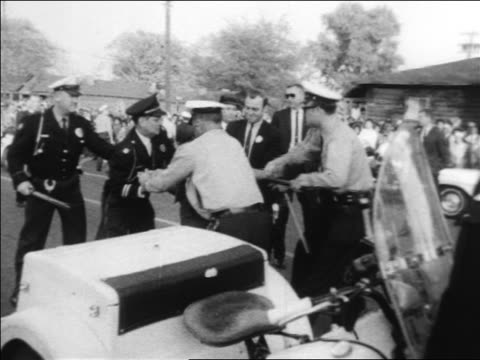 B/W 1963 policemen using force to arrest angry Black woman at civil rights protest / Alabama / news