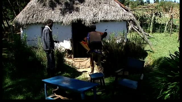 UN calls for international action Alice Juma Otieno along through field with reporter tearing up photograph of President Mwai Kibaki in her hut and...