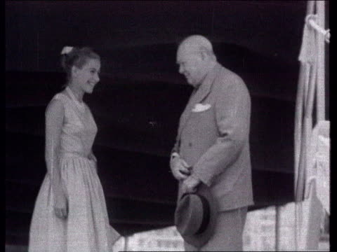 Bondevik Suffering from Depression LIB Sir Winston Churchill standing next woman on boat and giving `V' sign B/W Motor boat B/W Churchill B/W Cloudy...