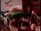 Devolution result EEN WALES Cardiff Ron Davies MP onto platform for pkf as crowds applaud Ron Davies and two other ministers holding arms in air...