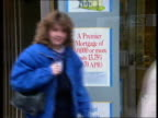 Poll Tax Tory Councillors Resign CMS People towards out of building society ZOOM IN sign giving details of mortgage interest rates TO