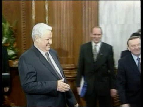 Russia Tightening Grip on Chechnya POOL Yeltsin thru room to meet Chinese President Jiang Zemin PAN as men embrace