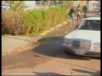 UN Weapons inspectors ITN IRAQ Baghdad Limousine towards Convoy away Meeting between UN inspectors Iraqi leaders including Deputy Prime Minister...