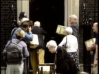 State Pension Demonstration ITN ENGLAND London Downing Street No 10 MS pensioners delivering boxes containing petition to No 10