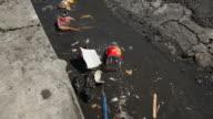 CU Polluted gutter and street / Roseau, Dominica