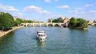 Pont Neuf bridge with boat in Paris, France