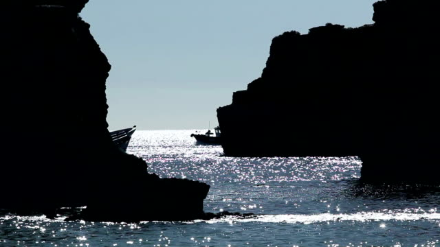 MS Ponta da Piedade rocks with boats in background / Lagos, Algarve, Portugal