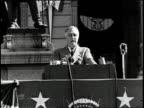 Poor audio/ President Roosevelt gives speech in outdoor setting in front of stone building /