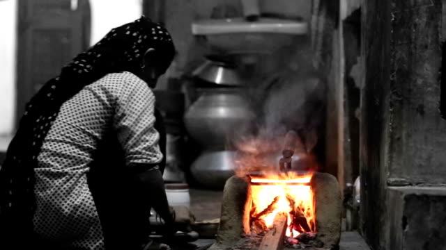 Poor women preparing food