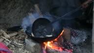 Poori (Indian Food) frying in cooking pan